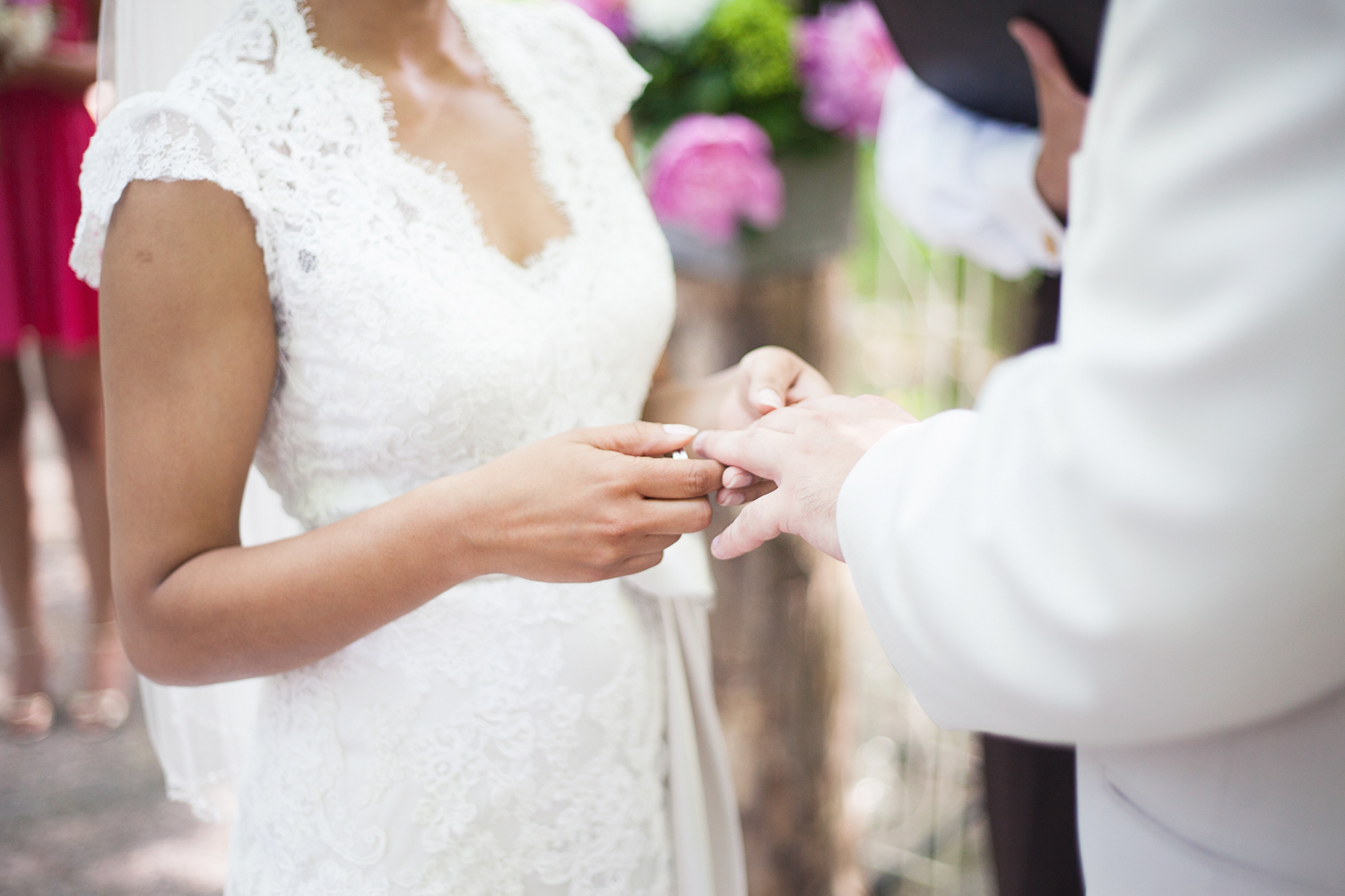 Bride exchanges rings with groom