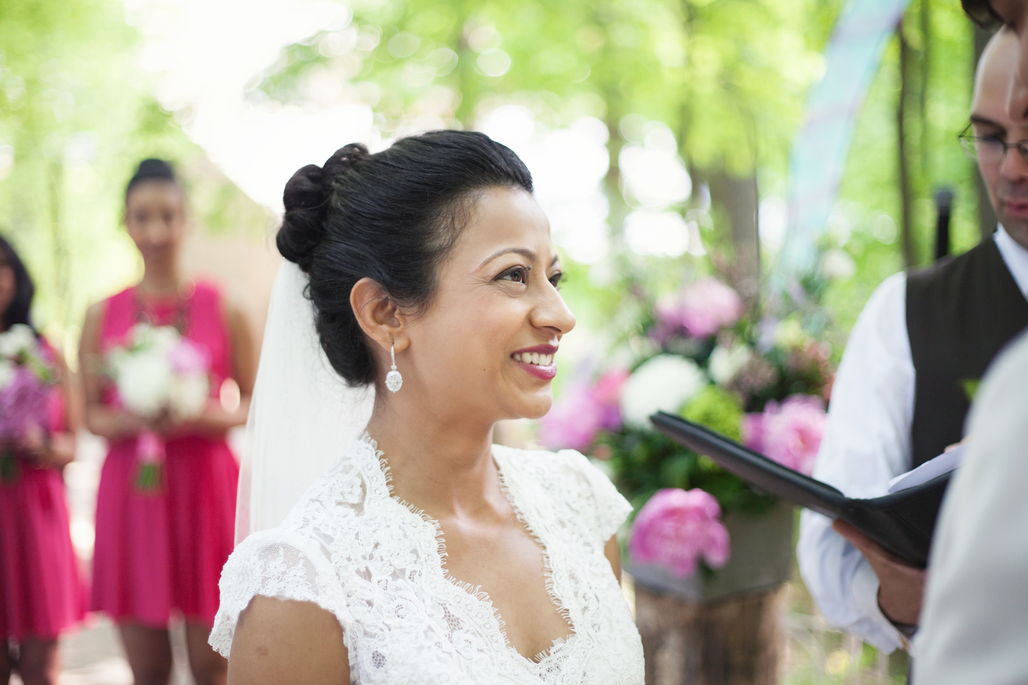 Portrait of smiling bride outdoors