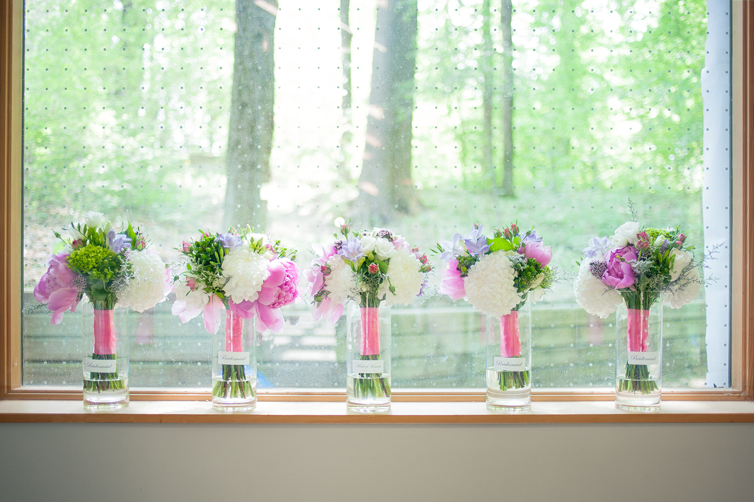 vases with flowers in window
