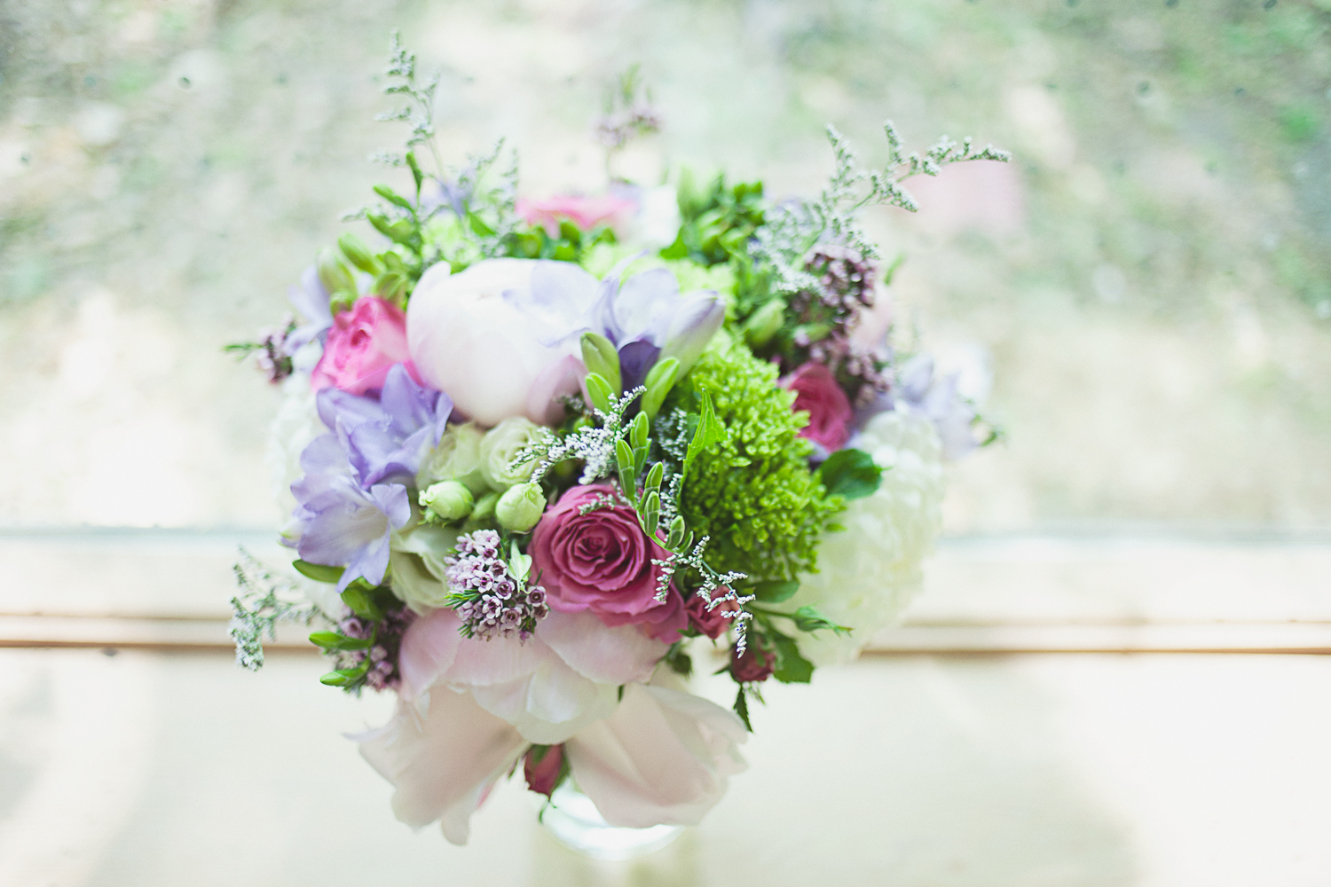 Bridal bouquet in front of window