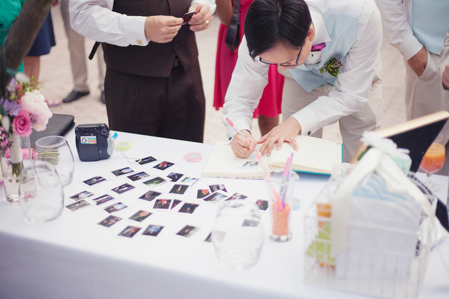 wedding guests leaving messages on polaroids
